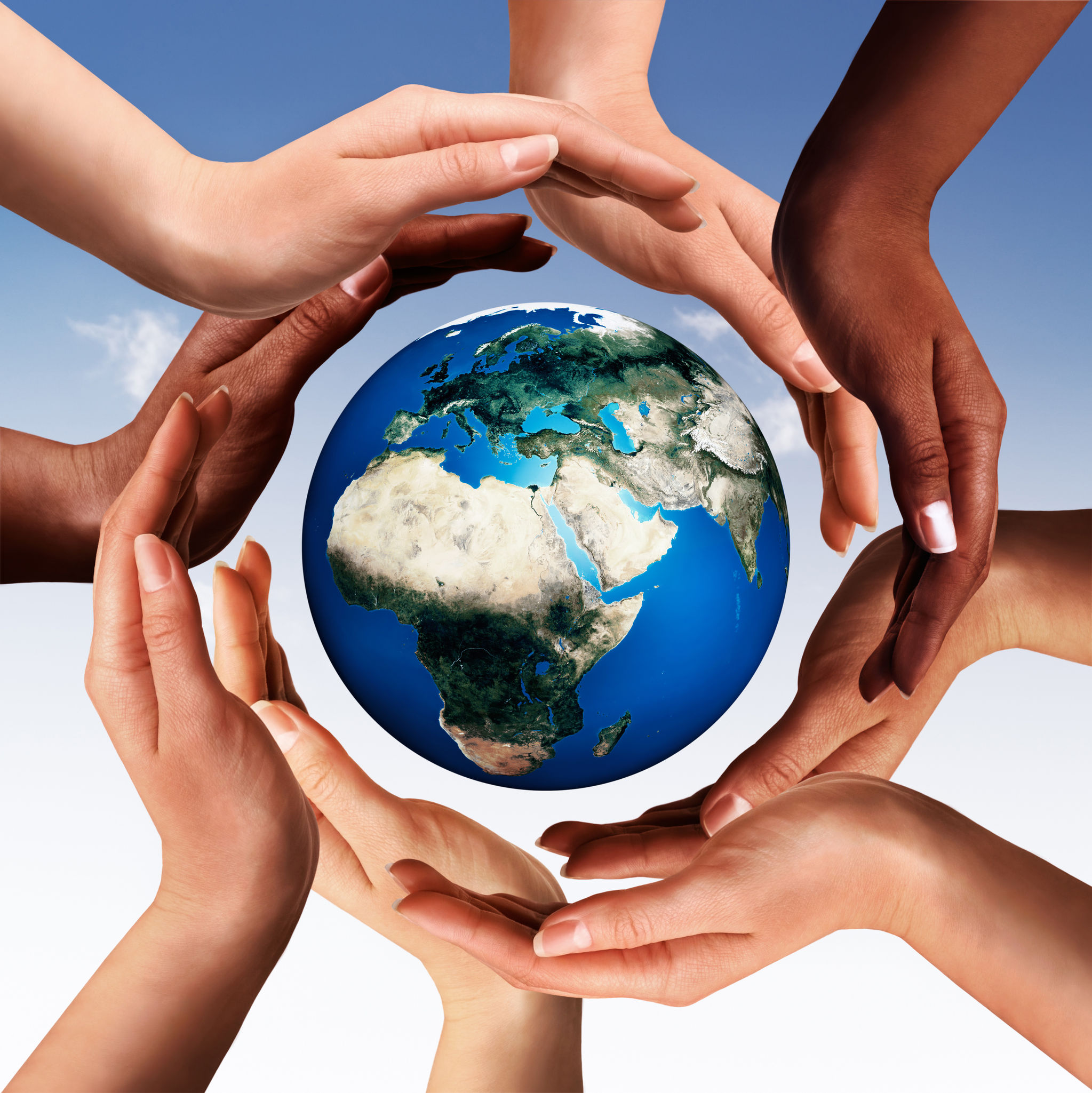 40110971 - conceptual peace and cultural diversity symbol of multiracial hands making a circle together around the world the earth globe on blue sky background